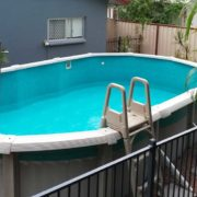 Above ground vinyl pool liner installation finished with repaired copings