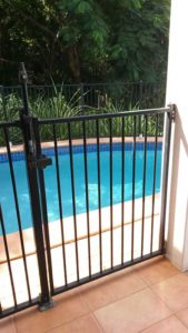 Repaired pool fence and gate