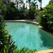 Staff cleaning a 181 Apartments Cairns swimming pool