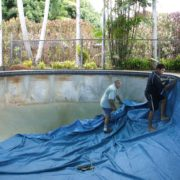 Installing vinyl pool liner at White Rock