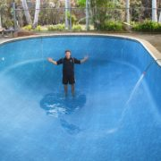 Completed White Rock vinyl pool liner installation with water being refilled