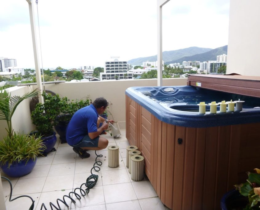 Cleaning spa filters at Accent apartment in Cairns